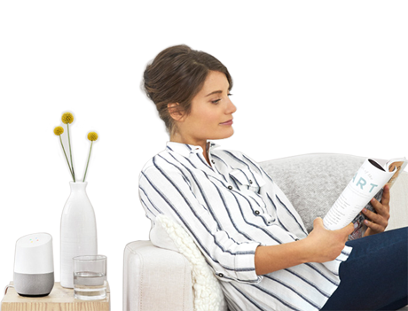 Woman in Chair Listening to Google Home Music